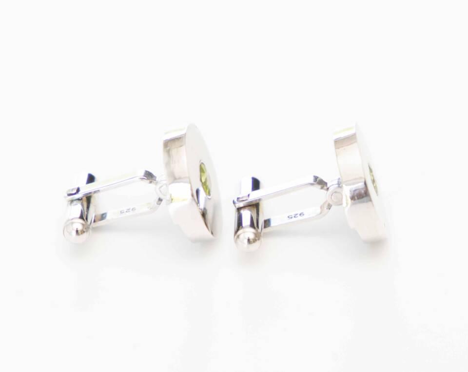 manchetknoop met peridot zilver witgoud