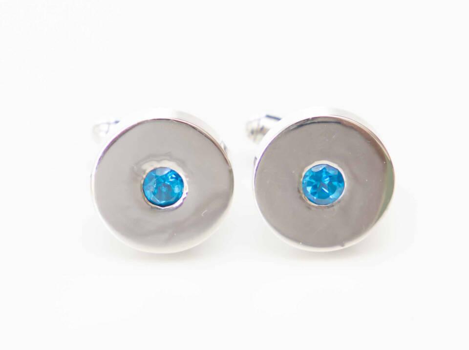 manchetknoop met blauwe topaas zilver witgoud
